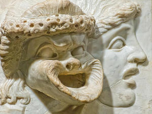 Carved Marble Relief depicting tragic and comic masks Roman 2nd century CE